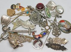 A mixed lot of mainly brooches and costume jewellery, a Golden Shred badge etc.