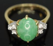 A diamond and jade cabochon ring, the central jadeite jade cabochon measuring approx. 9mm x 8mm x