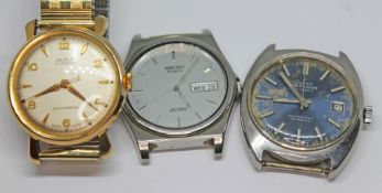 Three vintage wristwatches comprising a gold plated Olma 17 jewel manual wind on flexi strap, a