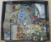 A box of vintage costume jewellery including stickpins etc.