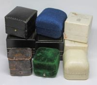 A group of nine ring boxes.