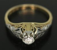 An Art Deco diamond solitaire ring, the modern round brilliant cut stone weighing approx. 0.20