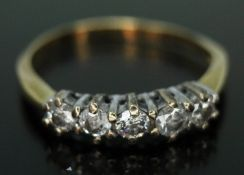 A five stone diamond ring, 18ct gold import marks, gross wt. 2.03g, size K (band bent).