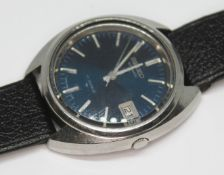 A vintage stainless steel Seiko automatic 7005-7100, with signed blue dial, hour batons and hands in