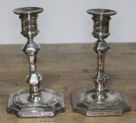 A pair of hallmarked silver candlesticks, height 15cm.