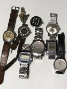 A mixed lot of modern and vintage wristwatches.