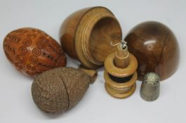 A treen egg shaped sewing etui, a walnut thimble case with hallmarked silver himble and a coquilla