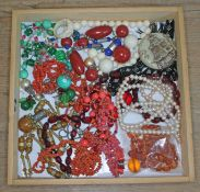 A mixed lot of costume jewellery including coral, bakelite, amber etc.