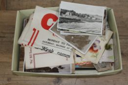 A box of postcards.