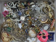A box of costume jewellery including a cameo pendant, rings etc.