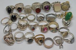 A group of silver and other rings.