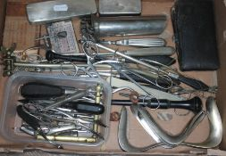 A selection of vintage dental and medical instruments.