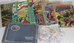 A quantity of vintage comics including superman and doctor strange, stamps and cigarette card album.