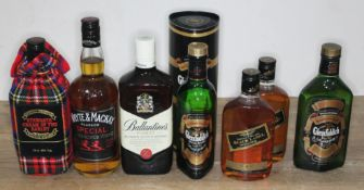 Seven bottles of blended and single malt Scotch whisky comprising Ballantine's Finest 70cl,