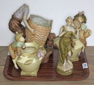 Four Royal Dux figures comprising a pair of vases with boy and girl, boy with large basket and dog