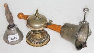 Vintage brass counter bell, dinner bells and hand bell.