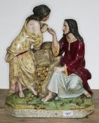 A large 19th century pottery figure group after Carrier Belleuse depicting a courting couple by a