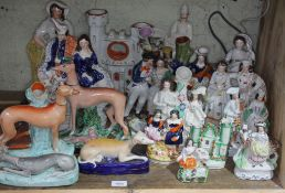 A collection 19 mainly 19th century Staffordshire figures including flat backs, dogs, etc, tallest