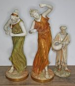 Three Royal Worcester blush ivory porcelain figures comprising two musicians and a water carrier,
