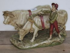 A Royal Dux figure group of a boy and two oxen, model number 837, height 27cm, length 39cm.