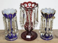 A pair of blue glass bohemian drop lustre vases together with another single red glass drop lustre