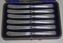 Cased set of hallmarked silver handled knives.