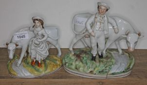 Two 19th century Staffordshire figures and cows with maid and farmer, heights 21cm & 17cm, lengths