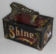 A vintage shoe shine box.