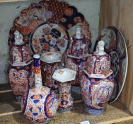 A collection of 8 pieces of Imari pottery, 19th century and modern, comprising two chargers and