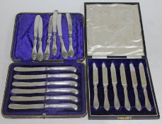 Two cased sets of hallmarked silver knives and another set.