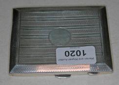 A hallmarked silver cigarette case, wt. 4oz.