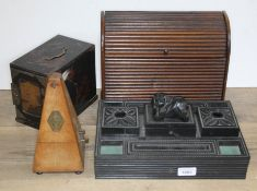 A mixed lot of treen comprising an ebonised eastern desk stand, a chinoiserie trinket box, a
