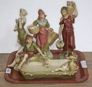 A group of four Royal Dux figures comprising water & food carriers, a musician and a dish with boy