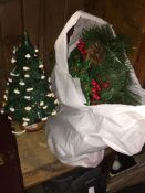 A light-up pottery Xmas tree and a bag with a xmas wreath The-saleroom.com showing catalogue only,