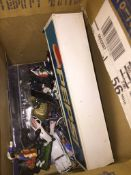 A box of model cars and Military figures The-saleroom.com showing catalogue only, live bidding