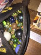 A bag of marbles The-saleroom.com showing catalogue only, live bidding available via our website. If