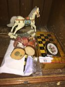 A wooden box travelling chess set, a draughts set and several small wooden figure ornaments The-