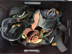 A box containing Petzl harness and others. Catalogue only, live bidding available via our website,