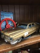 A vintage Bandai tin plate Cadillac with remote Catalogue only, live bidding available via our