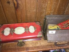 An Oriental padded jewellery box and a small metal tin trunk containing old small tins with