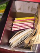 A box of misc to include OS maps, Marvel comics, transport pamphlets, a bag of badges and an album