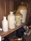 2 stoneware flagons, a stoneware bed warming bottle and a stoneware bottle. Please note, lots 1-1000