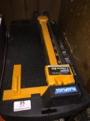 A 7 piece tiling toolkit. Please note, lots 1-1000 are not available for live bidding on the-
