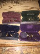 A collection of 4 old lorgnette glasses in cases. Please note, lots 1-1000 are not available for
