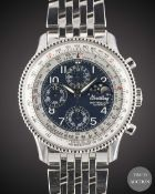 A GENTLEMAN'S STAINLESS STEEL BREITLING MONTBRILLIANT OLYMPUS NAVITIMER TRIPLE CALENDAR MOONPHASE