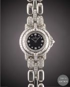 A LADIES 18K SOLID WHITE GOLD & DIAMOND BERTOLUCCI PULCHRA BRACELET WATCH CIRCA 1990s, WITH ORIGINAL