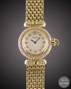 A LADIES 18K SOLID GOLD, DIAMOND & EMERALD TABBAH BERET BRACELET WATCH CIRCA 1990s, WITH ORIGINAL