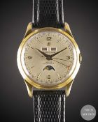 A GENTLEMAN'S GOLD PLATED BREITLING DATORA AUTOMATIC TRIPLE CALENDAR MOONPHASE WRIST WATCH CIRCA