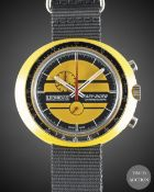 A GENTLEMAN'S RESIN CASED LEONIDAS EASY RIDER CHRONOGRAPH WRIST WATCH CIRCA 1970s, WITH YELLOW