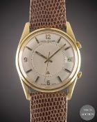 A GENTLEMAN'S 18K SOLID GOLD JAEGER LECOULTRE MEMOVOX ALARM WRIST WATCH CIRCA 1960s, REF. E11005